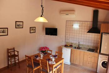 Essplatz und Küche der Suite