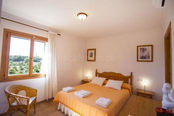 Schlafzimmer mit Bad en Suite und Klimaanlage