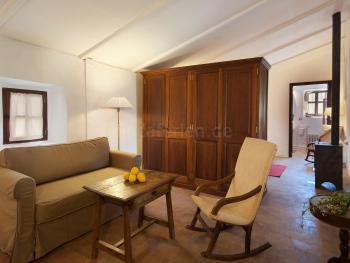 Sitzecke und Holzofen - Schlafzimmer