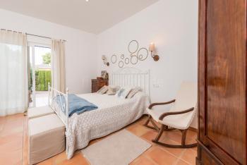 Schlafzimmer mit Klimaanlage + Bad en Suite