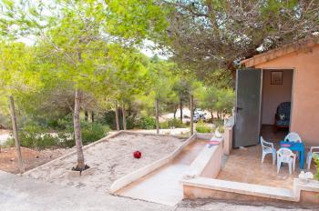 Sandkiste und Spielhaus